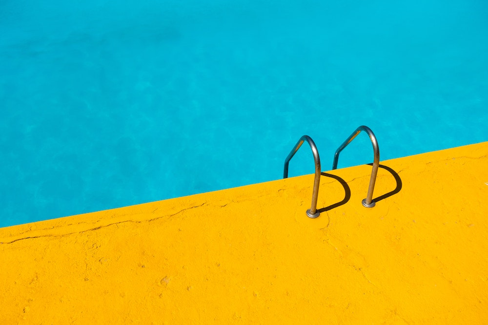 summer during the pandemic guidelines - yellow pool deck and water